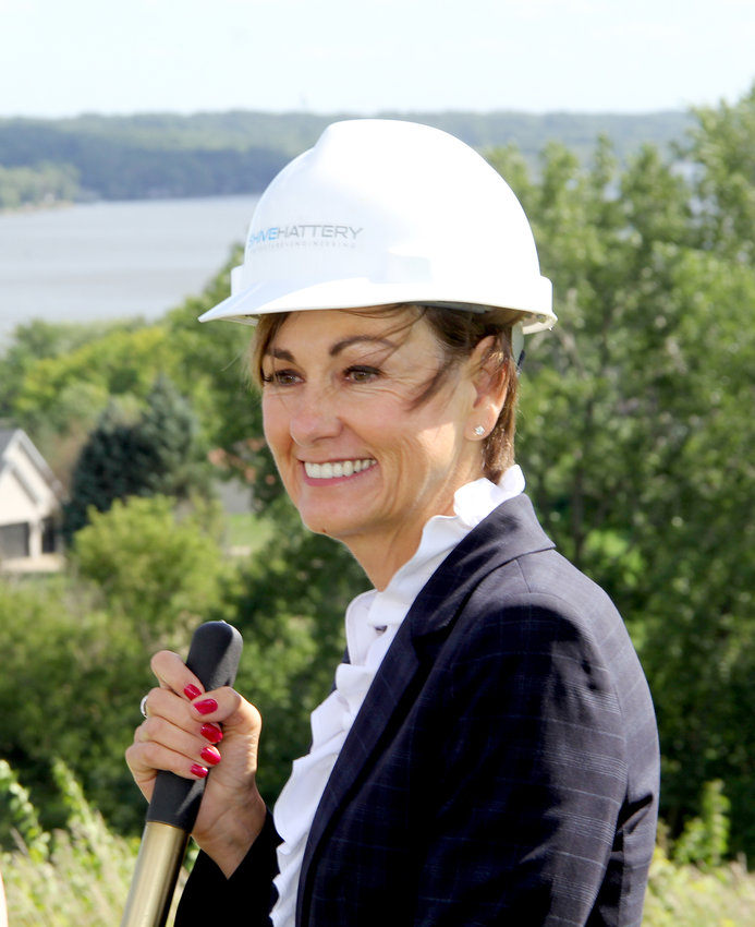 Iowa Gov. Kim Reynolds poses with a shovel.