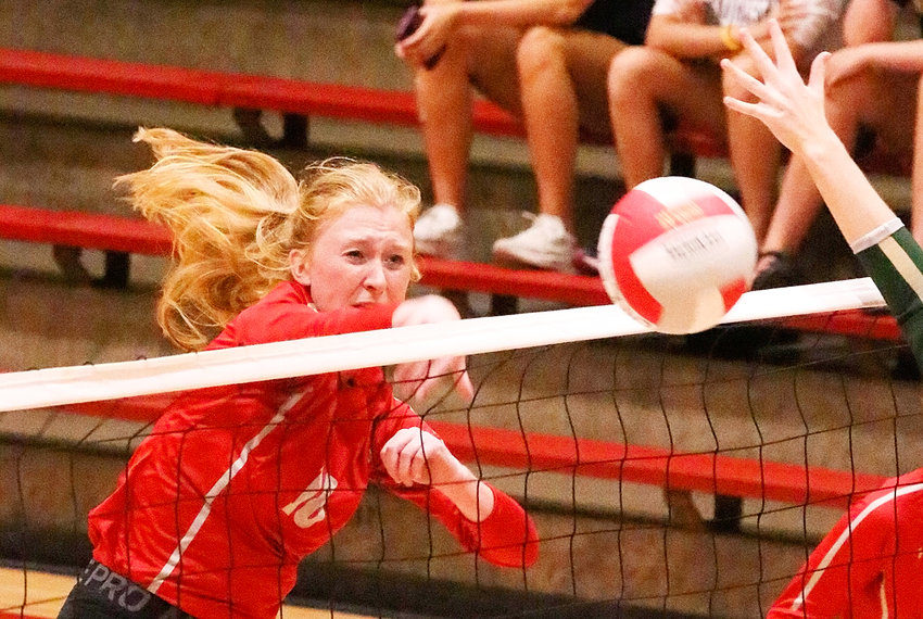 Senior Kendall McNaull delivers one of her five kills in the sweep of Iowa City West on Thursday.
