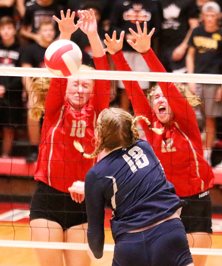 North Scott played well in its four-set loss to Pleasant Valley on Tuesday (Sept. 3), as evidenced by the strong net play of senior Kendall McNaull (l) and sophomore Ella McLaughlin, who teamed up to get this block.
