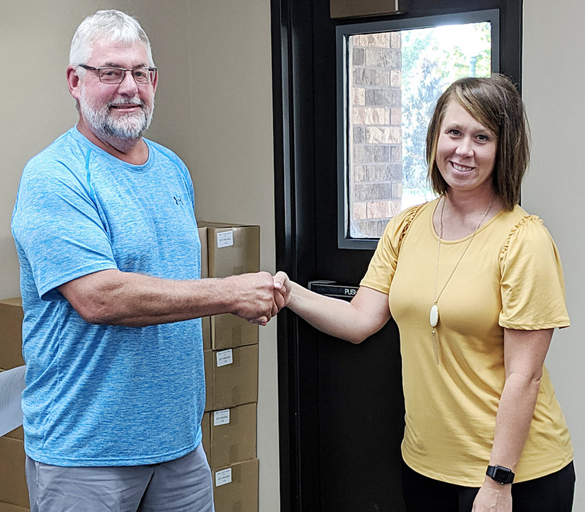 Durant Mayor Scott Spengler (left) welcomes Noel Price to the Durant city council as she was sworn in Sept. 9. Price will serve the remainder of member Brian Utter's term, which will run through the November elections.