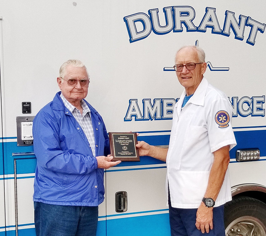 Bob Frey of Durant (left) is shown receiving an award of recognition for more than 40 years of driving the Durant Ambulance from Durant Volunteer Ambulance Service President Dennis Frisch.