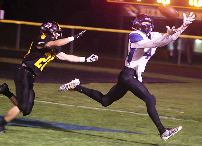 Durant's Jake Willkomm (right) looks to make a grab in road action at Tipton Sept. 13. The Tigers held on to beat the Wildcats 21-13. Willkomm had five catches for 135 yards and a touchdown.
