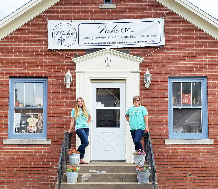 Taylor Armey and Deb Hartman of Niche etc. are shown outside their storefront in downtown Wilton. Located in the former law office of Dave Scieszinksi, Niche houses items from several local vendors and will host a vendor show Sept. 22 from 10 a.m. to 2 p.m.