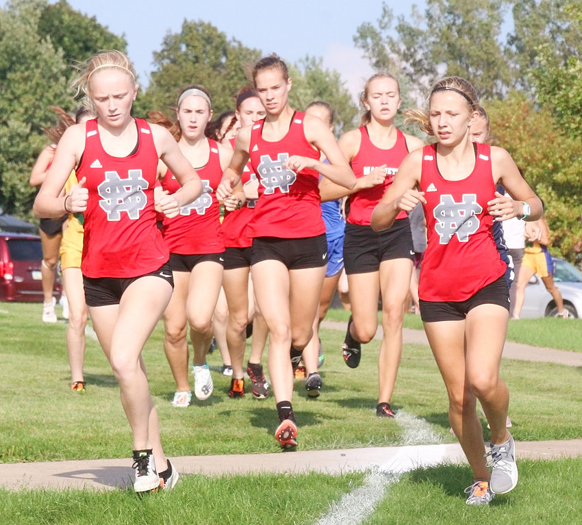 While Bailey Boddicker was running out front, this pack of Lancers wasn't far behind. From left: Abbi Lafrenz, Ava Garrard, Emily Kundel (partially hidden), Grace Sindt and Kaitlyn Knoche.