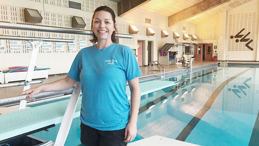 Stephanie Willey began serving as the Wilton Pool director in August. A former Wilton High School graduate, Willey is shown with the pool's brand new diving board, which was installed recently.