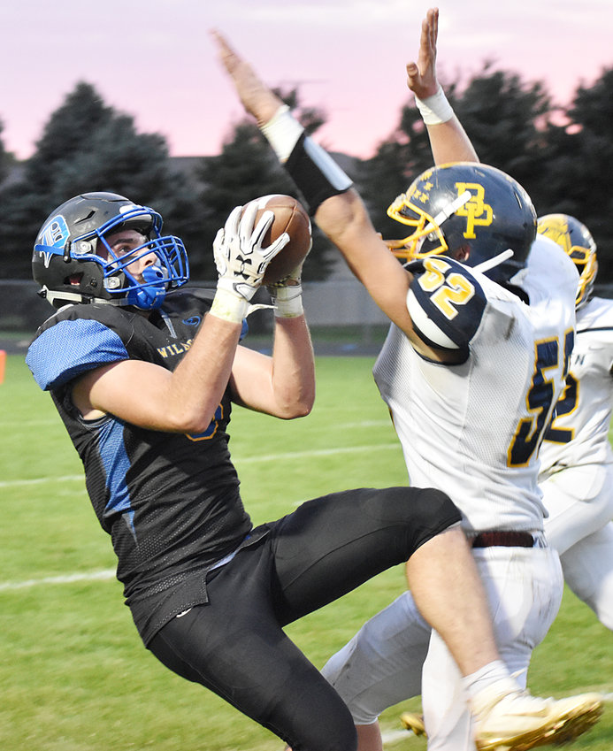 Durant's Marcus Engstler makes a catch through the outstretched arms of a Belle Plaine defender in home action Sept. 26. The visiting Plainsmen defeated Durant 32-14.
