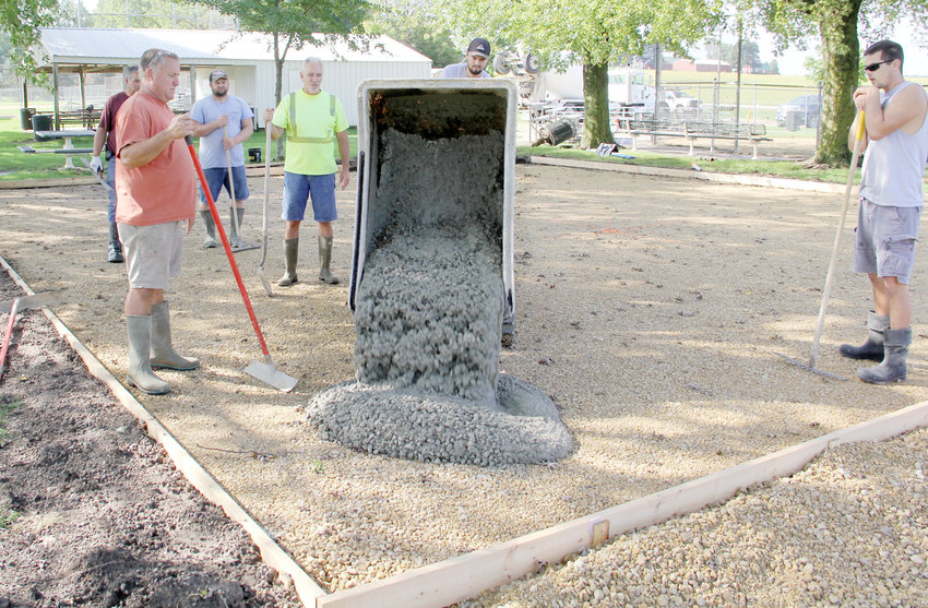 Brian Tobin and volunteers await the first load of concrete Monday.