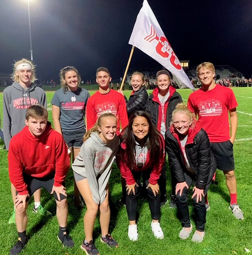 These North Scott seniors delivered the game ball from Iowa City Liberty on Friday night. Front (l-r): Blake Elgin, Zoe Warm, Juliana Schadel and Abbi Lafrenz. Back; Jake Blowers, Grace Gainer, Bryce Golden, Brenna Bullock, Emily Kundel and Ryan Mentzer. Chloe Brabant also ran but was already serving as a cheerleader when the photo was taken.