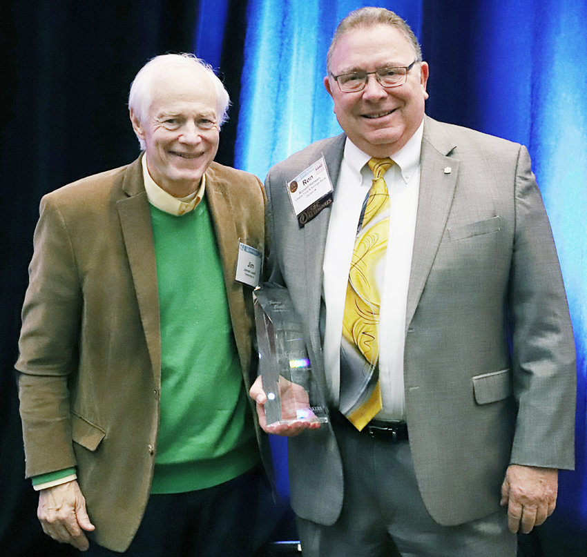 Ron Hansen (right) of Liberty Trust & Savings Bank in Durant is pictured with Jim Leach upon being presented with the James A. Leach Leadership Award Sept. 24.