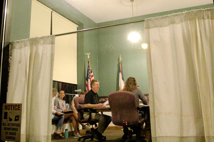 Long Grove mayor Mike Limberg reads the resolution selling Long Grove City Hall during the Oct. 8 council meeting.