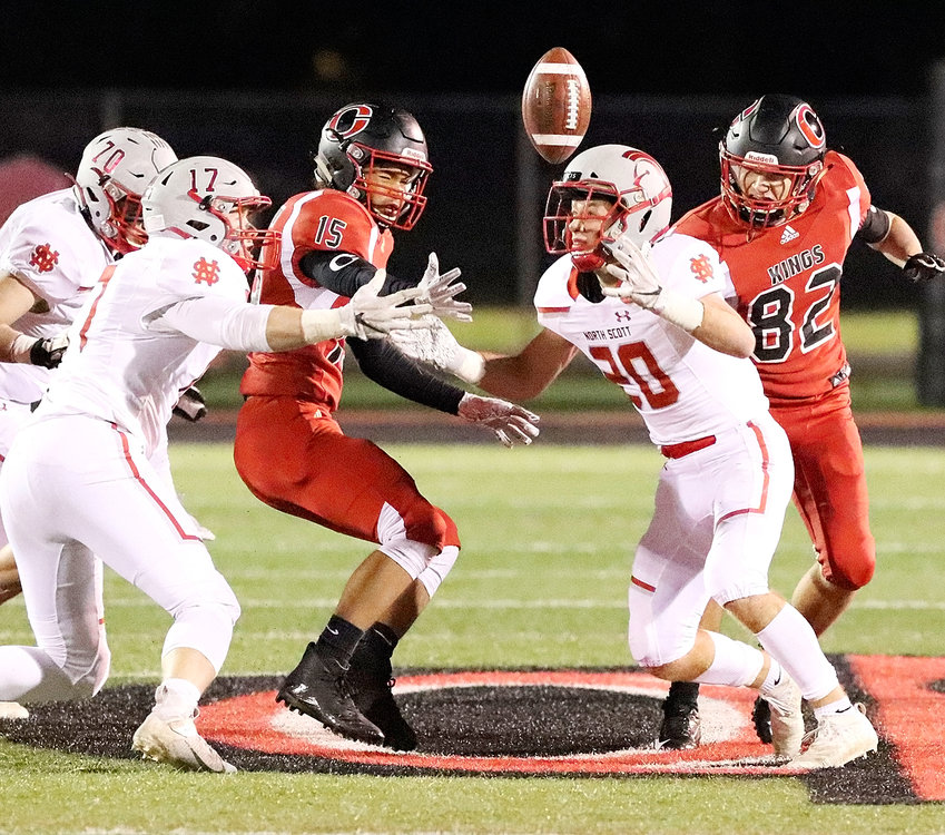 Seniors Nate Link (20) and Griffin Wilder have their eye on this loose ball after Clinton's Tavian Bailey coughed up a fumble. Unfortunately, the River Kings were able to recover it.