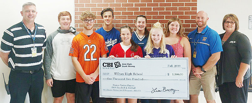 CBI Bank & Trust is the sponsor of the Beaver Nation program that spotlights the accomplishments of the student-athletes at Wilton High School. Monetary donations are made to the school several times a year after the varsity football, baseball, softball, and boys' and girls' basketball seasons. The bank presented a Beaver Nation check from the 2019 baseball and softball seasons recently, in the amount of $1,500. Since the Beaver Nation program was started in 2007, CBI Bank & Trust has donated a grand total of $48,550 to Wilton High School. Pictured above include: front row from left, Patrick Barszczewski, Emi Coss and Tessa Bartell; back row, WHS principal Marc Snavely, Jackson Hull, Chase Garvin, Mila Johnson, Taylor Garvin, WHS activities director Ryan Hetzler and CBI Bank & Trust Branch Manager Lisa Beatty.