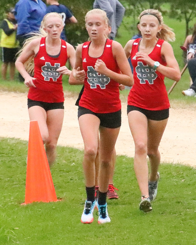 With less than a half mile to go at Thursday's Jim Hetrick Invitational, Lancers (l-r) Abbi Lafrenz, Bailey Boddicker and Kaitlyn Knoche were running in a tight-knit pack. Knoche went on to finish seventh, followed by Boddicker and Lafrenz.