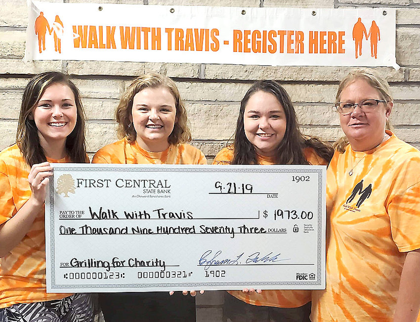 First Central State Bank's recent Grilling For Charity fundraiser generated $1,973 for Walk With Travis. There to celebrate the donation were (l-r): Madison Bennett, Dani Hair, Kilee Dinneweth and Tera Dinneweth.