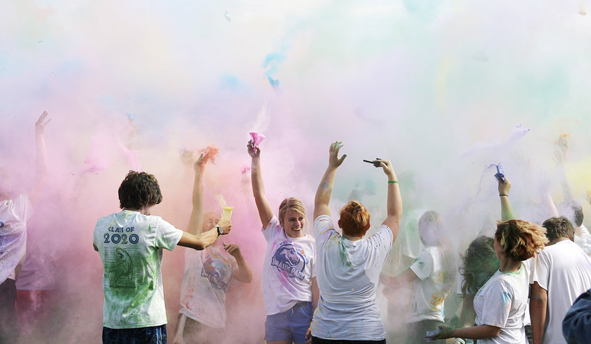 Wilton senior Emily Fausel (center) had the vivid idea to add a color run to Wilton's homecoming weekly activities. She pitched the idea of having a color run Oct. 3 during homecoming week. The school and students bought in and it was a success. Plans are to continue the event next year.