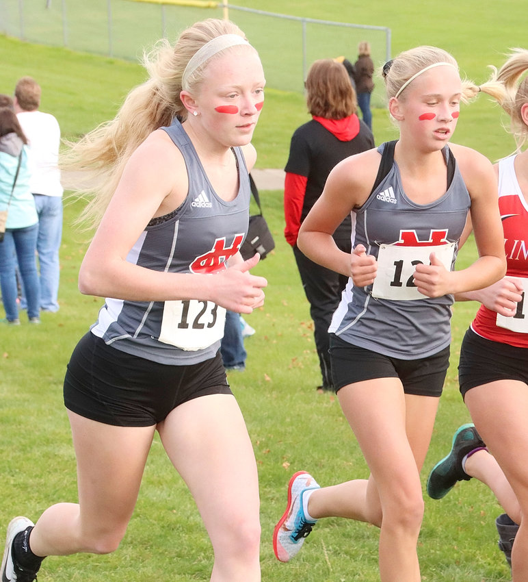 Abbi Lafrenz (l) and Bailey Boddicker will represent North Scott at Saturday's state cross-country meet in Fort Dodge after finishing 14th and 13th at Thursday's Class 4A district meet.