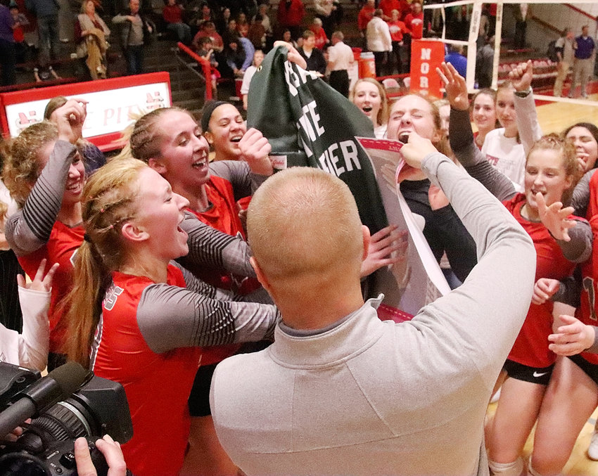 North Scott realized a dream come true Monday night when they swept past Burlington and got their hands on that much-coveted state tournament qualifier banner.