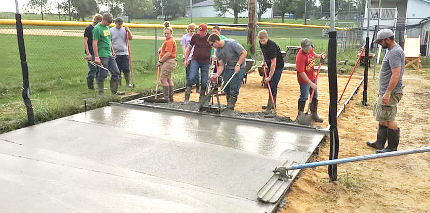 Improvements to the Durant High School baseball complex continued in September when several concrete baseball pads were formed as well as the foundation that serves as the flooring of the main batting cage. Durant High School industrial arts teacher and ACE Mentor adviser Tim Rouse facilitated the 3-day project. Students formed the five smaller pads, which allow baseball players to practice hitting off of batting tees, in addition to the batting cage floor. The concrete, which covers the old limestone, supports easier access to the batting cage after inclement weather. To finish the area off, concrete was also added to give foundation to the existing pitching cage. The use of all of the metal forms and forming materials were donated by Schwarz Grain and Fencing. The 3-day project was completed with the help of roughly 10-12 Durant ACE Mentoring students. Additional help was also provided by several community members, including Ross DeLong, Chuck Hamann, and Jeff Graves with a few of his employees. Hahn Concrete of Walcott provided support through a discount in the total cost of the concrete.