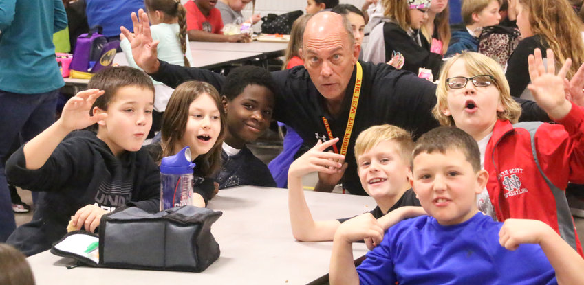 Frank Wood poses with Armstrong Elementary students in 2017 during his interim stint as Armstrong Principal.