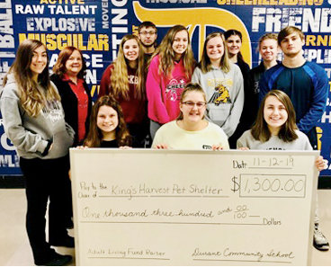 The Durant High School adult living class, led by adviser Mary Feuerbach, raised $1,300 for the King's Harvest No Kill Pet Shelter in the Quad Cities. Students raised $266.36 by having a baked goods and root beer float sale, $259 from the pre-K through fifth grade games assembly, and $80.75 from the sixth grade through high school games assembly. There were also private donations and class donations to add to the total. The winning class and winner of the root beer float party was Mrs. Myers' Learning Lab that donated $128.73. Louie Thoma also donated pet supplies collected at his birthday party. Pictured above include, front from left, Mariah Miller, Jenna Krause, Danielle Paulsen; back row, Addisyn Skinner, Mary Feuerbach, Tessa Brandenburg-Paxton, Tyler Ostofi, Cheyann Hilbert, Madison Semsch, Jasmine Ruggiero, Lillian Nielson, Cameron Ruggiero.