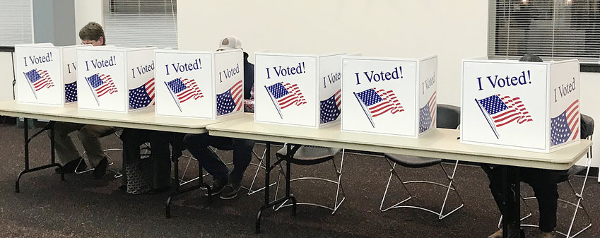 The voting tables inside the Wilton Community Center are shown on election night Nov. 5 during the city/school elections. With a total of 15 precincts counted in Muscatine county, 4,785 votes were cast of a possible 28,297 registered voters — a voter turnout of roughly 17 percent. In Cedar County, the numbers for 11 precincts were 2,427 of 12,380 casting votes (19.6 percent).