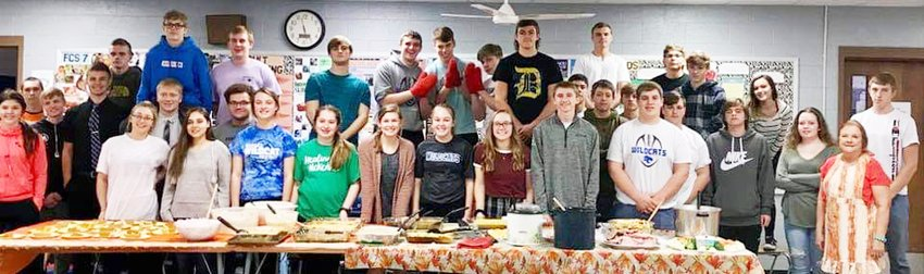 Thirty-nine Durant High School foods class students from both Durant and Wilton high schools prepared a Thanksgiving feast for office staff on Thursday, Nov. 21. Turkey, ham, pumpkin pie and 20 sides were prepared and served. The Durant High School staff enjoyed the meal on both Thursday and Friday. The foods students are pictured above, along with teacher Mary Feuerbach (right).