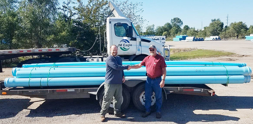 Kevin Gute, plant manager at JM Eagle in Wilton, is shown with Andy Fowler, an Iowa DNR Fisheries biologist at the Fairport Fish Hatchery where mussels will be raised along side the fish in order to introduce more to the Mississippi River. JM made a water piping donation in order to help the hatchery and the Mussels of Muscatine group in their efforts.