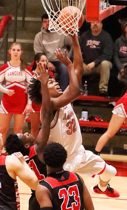 North Scott senior Ty Anderson goes up for two of his team-high 25 points in Tuesday (Dec. 3) night's season-opening win over Iowa City High.