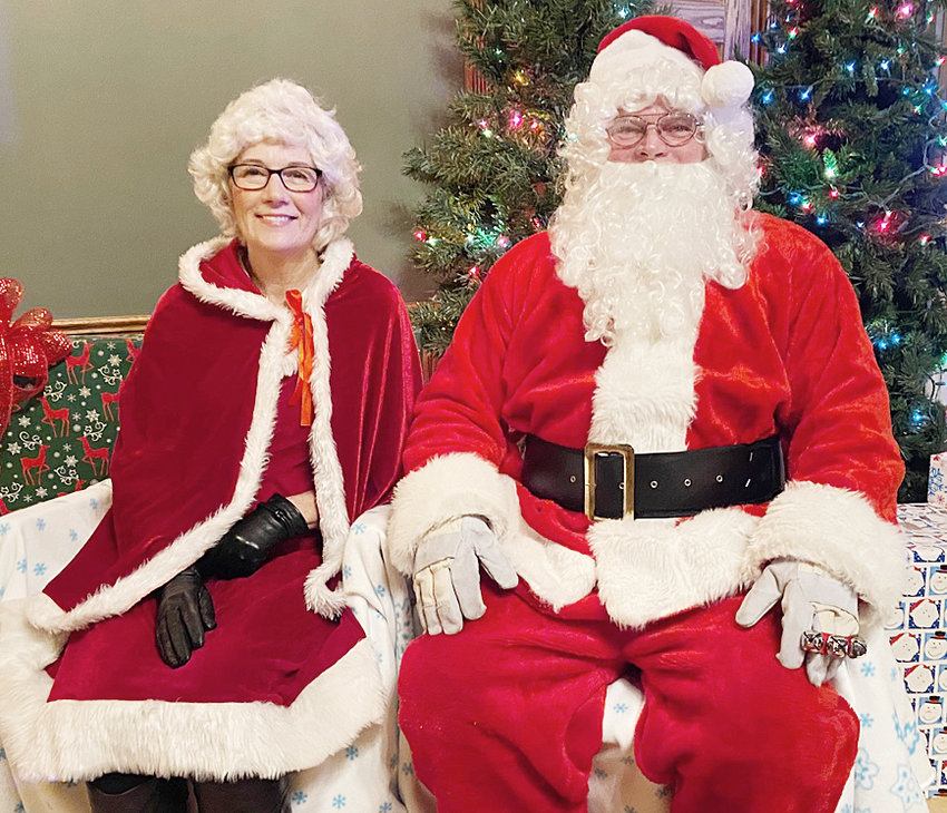 Santa and Mrs. Claus in the first picture of the night before seeing children.