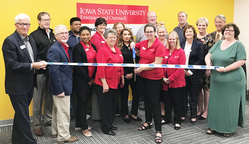 Ribbon cutting ceremony—The Iowa State University Muscatine County Extension and Outreach office held a grand opening event Oct. 10 at its new location in Muscatine. Events were held throughout the week Oct. 7-11, including a special ribbon cutting ceremony held during a public open house Oct. 10. Members of the Muscatine County staff and other business/elected officials are pictured at right.