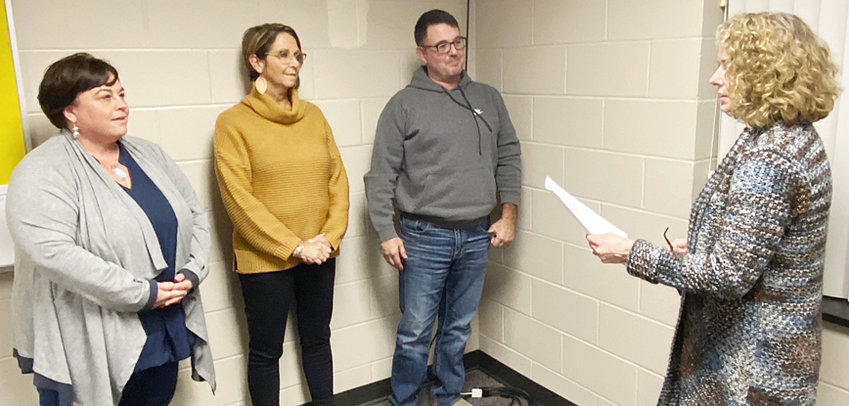 New Durant school board members Tara Lindsay, Carla Whitlock and Travis Bullard take the oath of office from board secretary Lesa Kephart.