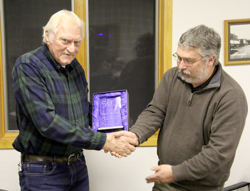 Princeton Mayor Roger Woomert accepts a plaque from Mayor-elect Kevin Kernan at the city's Dec .12 council meeting.
