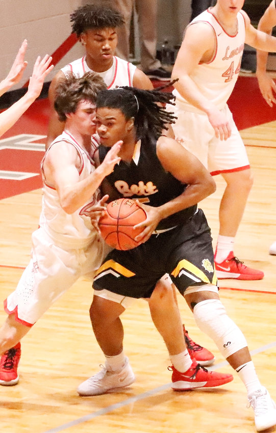 Lancer junior Carter Markham comes face-to-face with Bettendorf's Harrison Bey-Buie.
