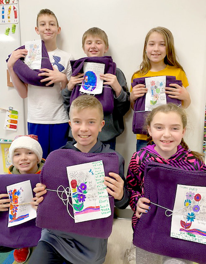 John Glenn fifth-graders created handwritten notes and drawings to share with recipients of blankets and care bags. From left: Trey Feist, Kyle Osborn, Nora Barnett, Dylan Ulloa, Kain Wulf and Molly Mose.