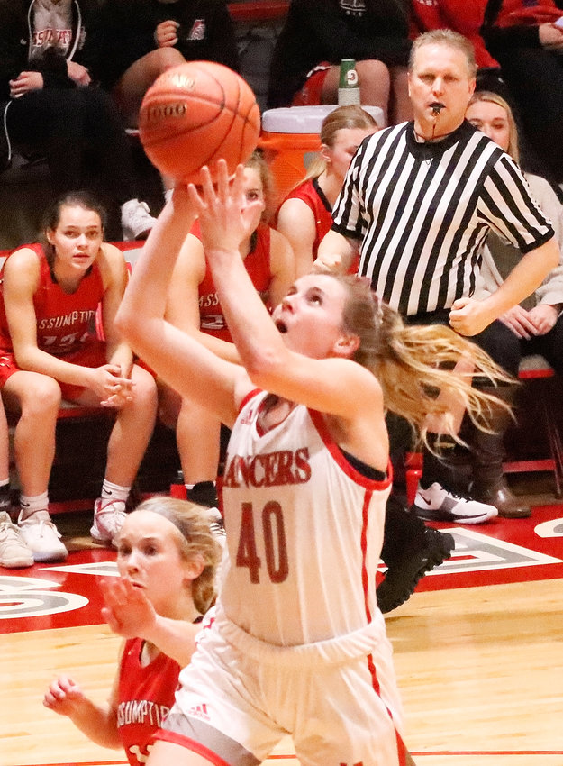 NS senior Adriane Latham is a key cog in North Scott's transition game, as evidenced by this fastbreak lay-up against Assumption.
