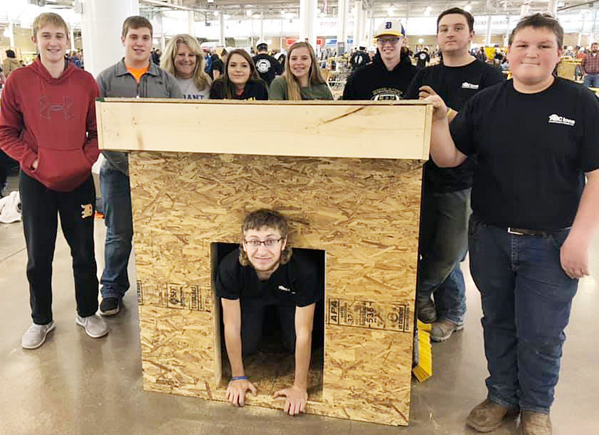 The Durant High School ACE (Associated Builders and Contractors) students attended the Associated Builders and Contractors of Iowa Carpentry Competition Dec. 22 at the Iowa State Fairgrounds. Tim Rouse took five students from the Durant ACE program to compete along side other high school students in building a doghouse from the ground up. Each team received building plans and materials to build their doghouse and had four hours to complete the project. Each team's doghouse was judged on accuracy, technique and teamwork. The Durant ACE students received fifth place in the competition. Pictured from left to right: Koby Paulsen, Brian Graves, counselor Kristy Badtram, Kaylee Behrensmeyer, Tessa Brandenburg-Paxton, Jason Arp, Trace Seligman, Spencer Meinert, Tyler Ostofi. Terry Esbaum not pictured. After completing their doghouse, the students took it back to Durant to put the finishing touches on it – complete with siding and a shingled roof. The students planned to give the doghouse to one of their own teammates with dogs or use it as a new can collector for the football stadium.