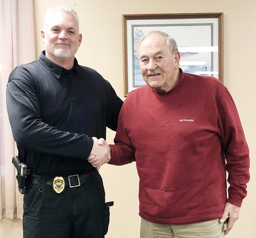 Dave Clark (left) of the Wilton Police Department shed the interim tag Jan. 13, as he was named the next Wilton Chief of Police. He's pictured above with Wilton Mayor Bob Barrett.