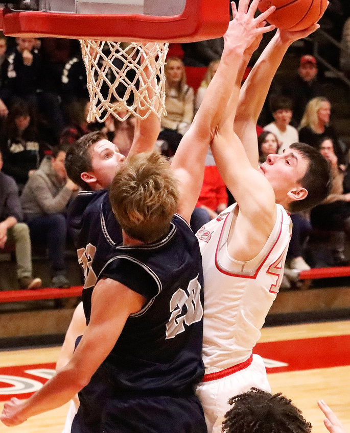 "Trent Allard was a terror around the rim Friday night as the 6'8"" senior scored a career-high 11 points in North Scott's 42-25 win over Pleasant Valley."