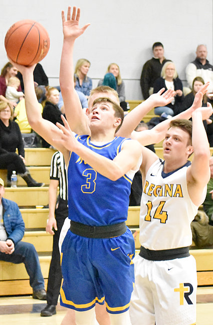 Wilton's Buddy Darting drives to the hoop in road action at Regina.