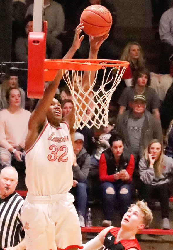 Lancer senior Ty Anderson was flying high as he converted this alley-oop pass from Sam Kilburg to start the running clock in North Scott's 72-33 win over Clinton Friday night.