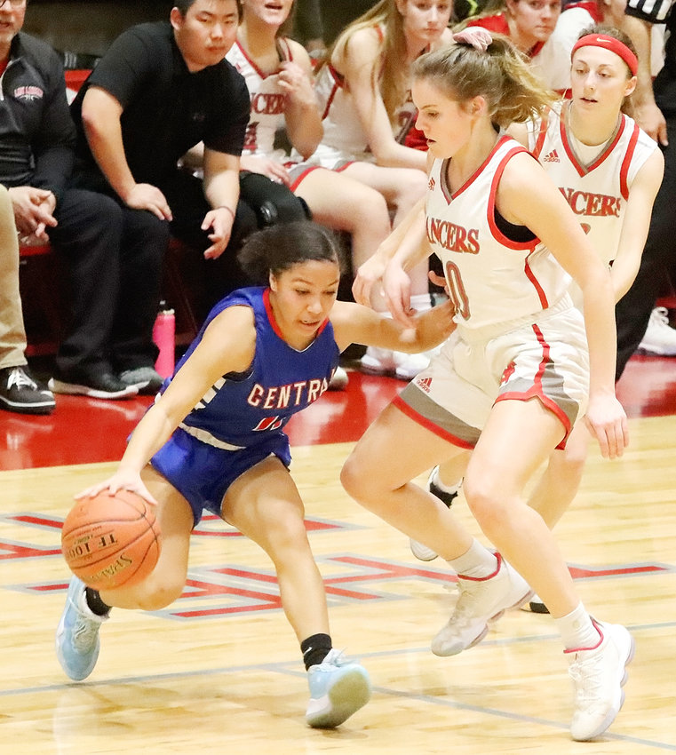 Lancer senior Adriane Latham didn't give Central's Aniah Smith much room to operate in North Scott's win over the Blue Devils.