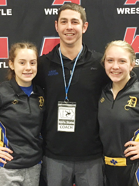 Durant's Carlie Jo Fusco (left) and Ellie Fuller-Long (right) are shown with head coach Casey Strub at the girls' state wrestling tournament held Jan. 24-25 in Waverly, where nearly 400 girls participated, up from less than 100 a year ago.
