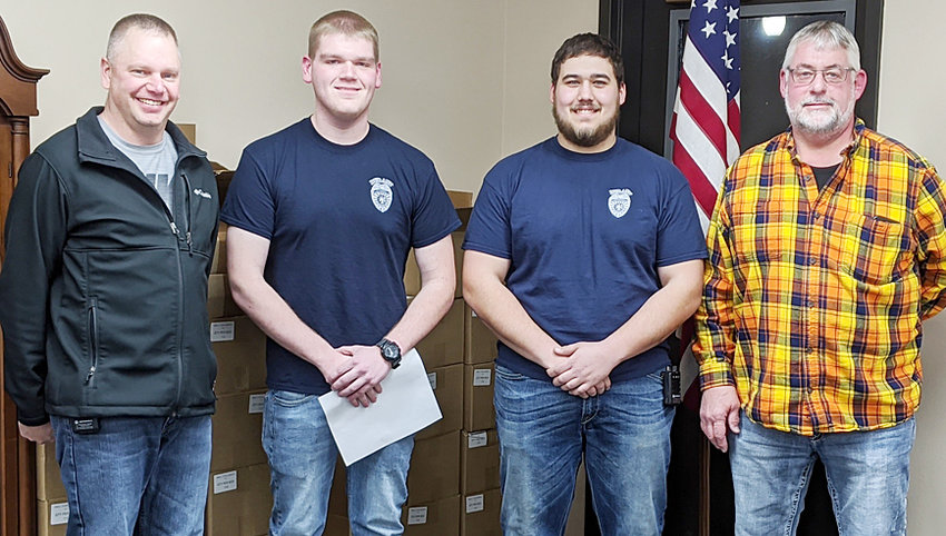 Matt Fisher (middle left) and Levi Novinski (middle right) were officially sworn into the Durant Fire Department Feb. 10. They are pictured with Fire Chief Jared Semsch and Mayor Scott Spengler.