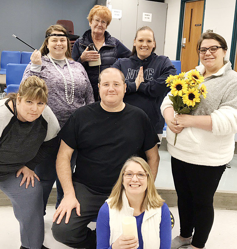 """Pictured above are cast members in the upcoming Wilton Fine Arts Guild play """"The Addams Family, a New Musical Comedy."""" They include Marlyin Robert as a pirate, Amber Brown as a nun, Stevie Whitehead as a bride, Brenda Ochiltree as a flight attendant, Pam Cantrell as a cave woman, Teri Walsh as a 1920s flapper, and Mark Lawrence as Uncle Fester."""