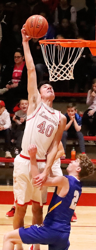 NS senior Trent Allard delivered a pair of dunks against North, and this one-handed gem was nothing short of spectacular.