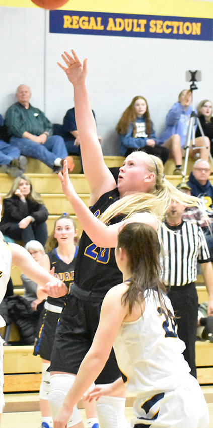 Durant's Allie Poston stops in the lane for a short shot on the road at Regina in Regional play.