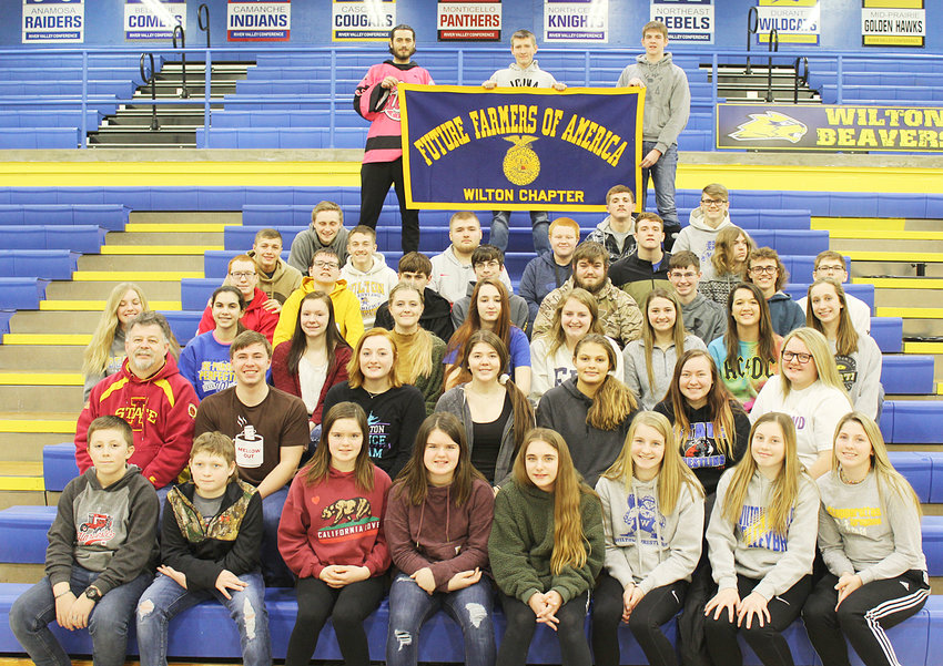 National FFA Week is recognized Feb. 22-29. Students pictured above are part of the Wilton FFA Program. Front row L-R: Damian Dann, Clay Ledger, Madelyn Thede, Kaitlyn Thede, Jessica Mach, Hannah Rogers, Kaydence Boorn, Ansley Boorn. 2nd row L-R: Gary Bruns, Colby Brown, Olivia Mollenhauer, Alexa Garvin, Hayley Madlock, Cheyenne Rae, Daelyn Cooling. 3rd row L-R: Jayden Anderson, Zoe Barrett, Becky Imhoff, Anna Marine, Kylee Pleggenkuhle, Taylor Schult, Madelyn Wade, Joann Martin, Kiley Langley. 4th row L-R: Matthew McDonald, Tucker Treimer, Tyler Mach, Ryan Cerveny, Grant Conway, Gavin Reid, Trae Hagen, Colton Cruse. 5th row L-R: Buddy Darting, Dalton Snider, Michael Proctor, Hunter Rummells, John Lilly, Gage Hagen. 6th row L-R: Izack Loveall, Coy Baker, Wyatt Van Dusen. Holding sign L-R: Sam Nelson, Hunter Hartung, Mason Nolte. Some FFA members were absent from the photo.