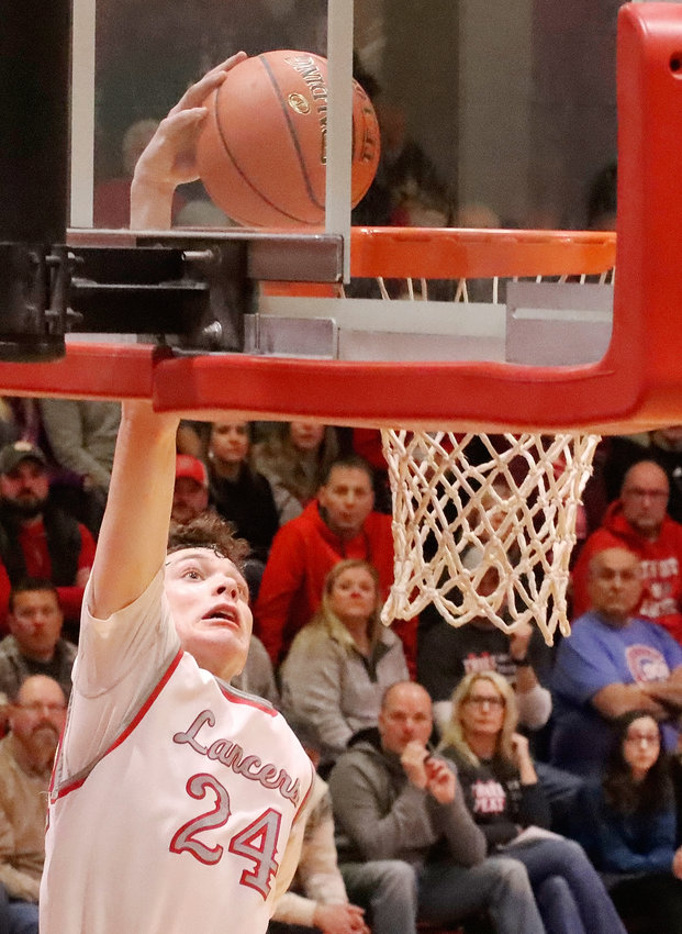 Junior Landon Eiland delivered a spectacular one-handed jam as part of his seven-point night against Cedar Rapids Kennedy.