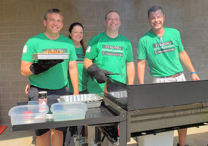 First Central State Bank Grilling For Charity team members (l-r), Scott Levine, Brandi Lord, Chad Ulrich and Scott Jansen, were part of the crew working in fall 2019 to raise money for the Walk With Travis organization. The event raised $1,973 for the Eldridge-based organization. First Central is part of Ohnward Bancshares, Inc., which donated $450,000 to causes in eastern Iowa communities during 2019.