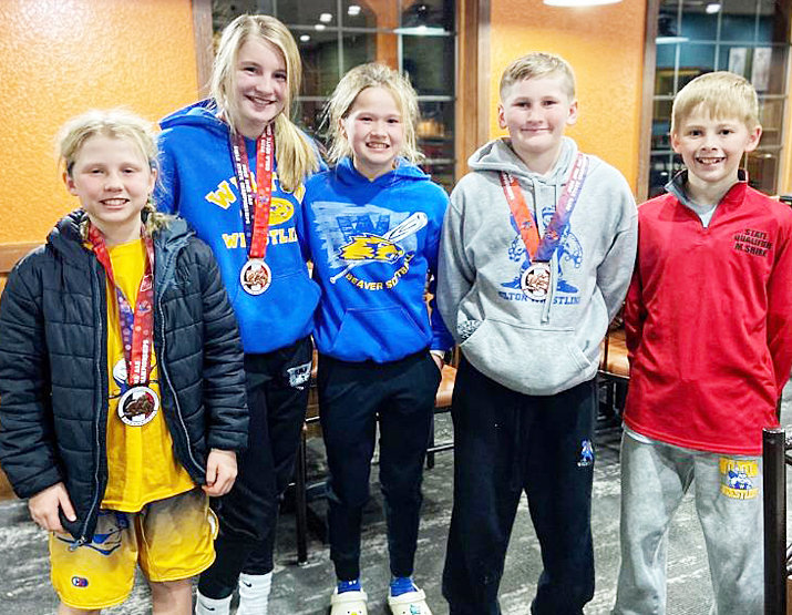 Wilton Wrestling Club members competed at the AAU state wrestling tournament this past weekend. Members pictured placed at state (from left): Josslyn Holladay placed third, Hannah Rogers placed fifth, Audra Coss placed sixth, Jensen Boorn placed seventh and Mason Shirk placed seventh. The following wrestlers qualified for state but did not place: Michael Elam, Dawson Kaska, Dean Harris, Hunter Jones and Declan Conklin.